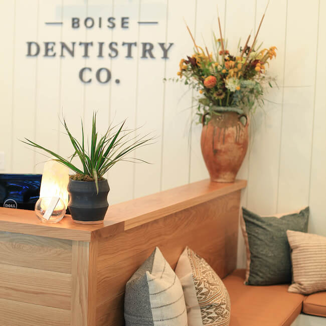 Boise Dentistry Co. Reception area for new patients with the sign in the background