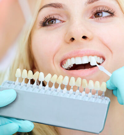 Closeup of a girl with beautiful smile at the dentist.